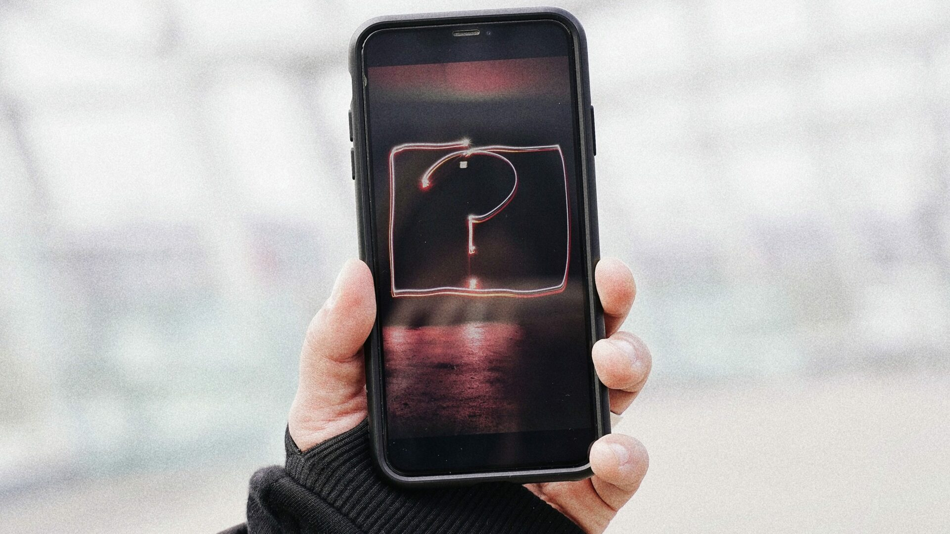 Hand holding smartphone with question mark on the screen (Photo by Olenka Sergienko on Pexels.com)