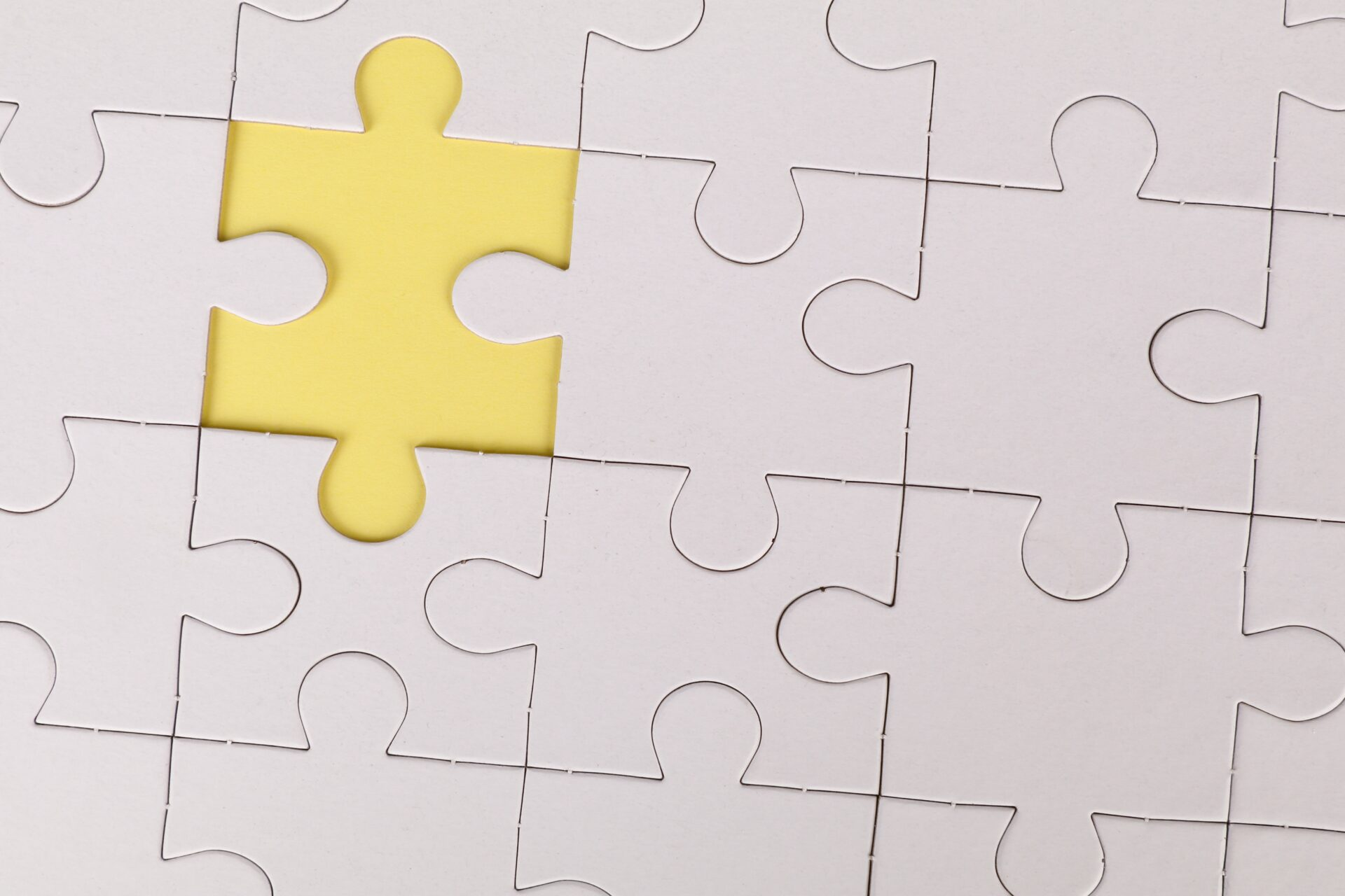 A plain white jigsaw missing a piece (Photo by Ann H on Pexels.com)