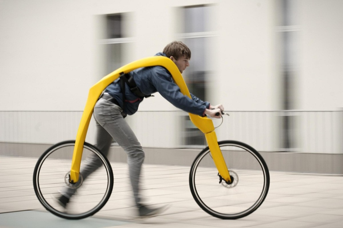 The FLIZ bicycle suspends a man from its frame so he runs instead of pedals